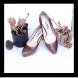 PRADA SPAZZOLATO FUME BROWN PLATFORM HEELED PUMPS